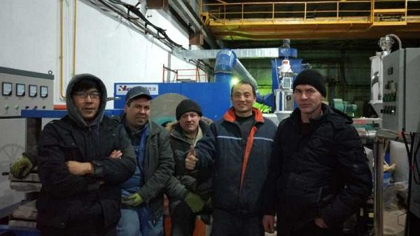 华仕达专家在哈萨克斯坦调试3PE钢管防腐生产线
